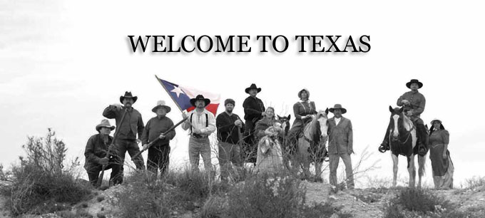 """This is an image that says """"welcome to texas."""" It is black and white except for the texas flag, which is in color. There's an array of cowboys and pioneer women standing, looking proud. Like Texans like to think they all look."""