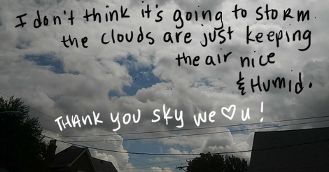 """This photo of heavy cumulus clouds has written on it: """"I don't think it's going to storm, the clouds are just keeping the air nice and humid. thank you sky we love you!"""""""